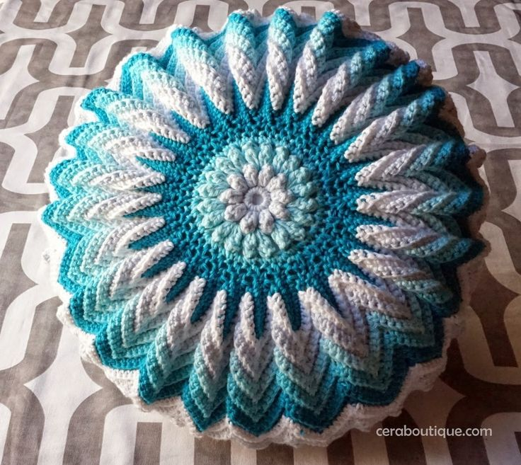 I picked up this sweet little booklet at my local craft store,Bright IdeasPattern Book, by Lily Sugar n' Cream. This is a round pillow with a burst of sunshine. For my versionI used a 5mm hook a...
