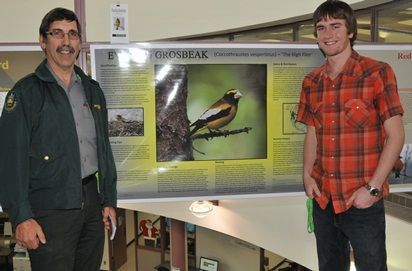 Richard Ellens, a second-year environmental sciences student in the wildlife and fisheries conservation major, shares his poster project on the Evening Grosbeak with Alberta conservation officer Gary Walsh at Lakeland College's Vermilion campus on Dec. 5, 2011. The poster presentation was part of an ornithology term project which focused on Finches and Blackbirds. Lakeland College's environmental sciences program and the Vermilion River Naturalists Society also c