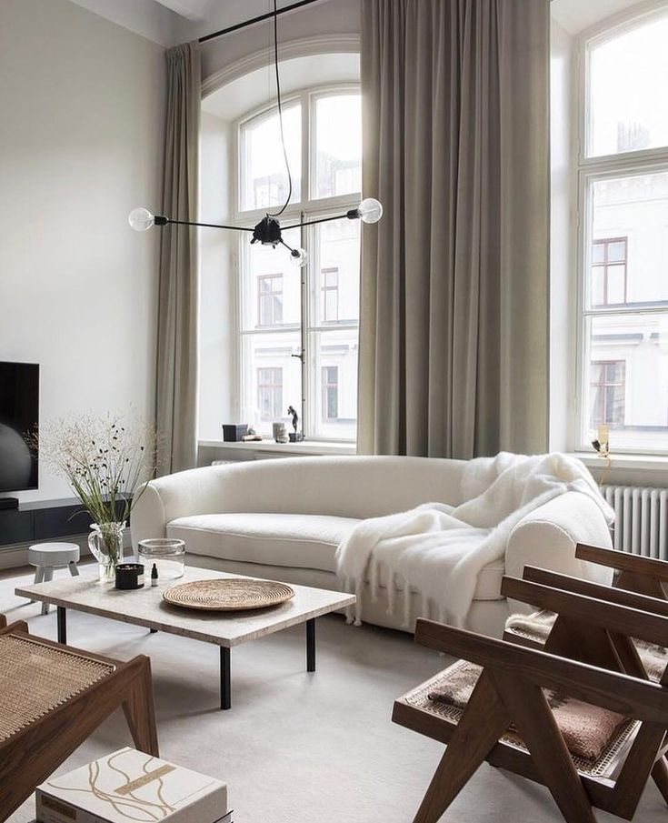Serene and elegant living room design by Andreas Martin-Löf   Neutrals - white, off white, browns, black.