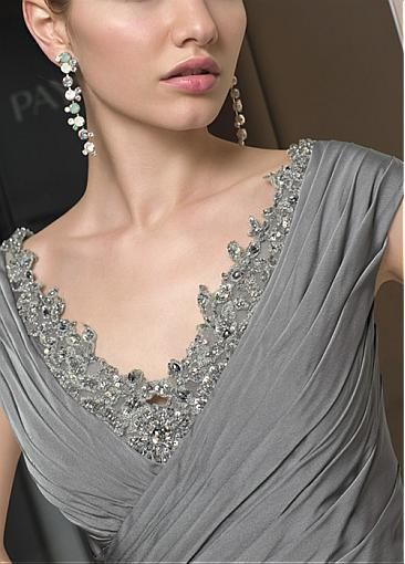 beautiful lace neckline and accessories on this mother of the bride dress