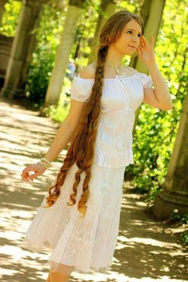 Portrait Of A Beautiful Woman With A Very Long Braid