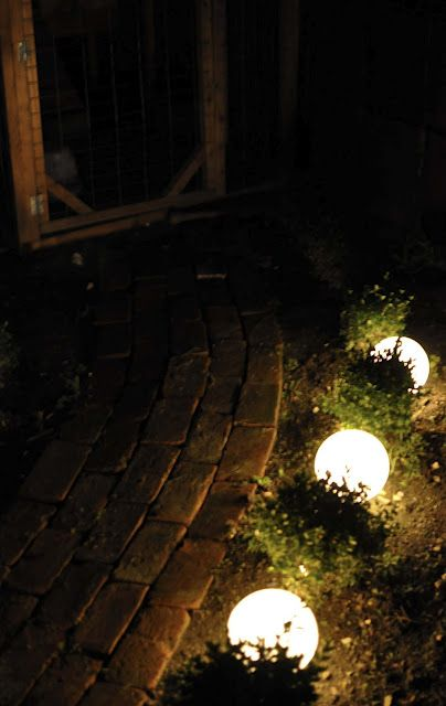 white globe covers for ceiling fixtures transformed into outdoor lighting...strings of Christmas lights tucked into them..