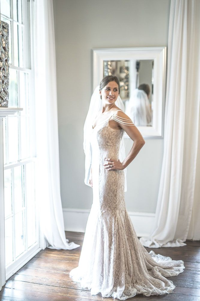 New (Never Worn) Alfred Angelo - 8531 - We can't stop swooning over the modern vintage sentimentality of this stunning gown by Alfred Angelo. It features all-over intricate lace, a romantic trumpet silhouette, a godet skirt, beaded spaghetti straps, and off the shoulder draped pearl detailing.