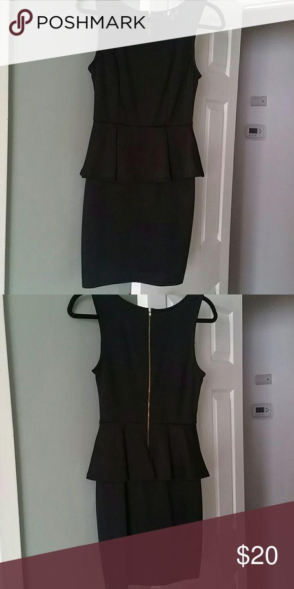 Black peplum  dress Black peplum dress fits very nice. Perfect condition Dresses Midi