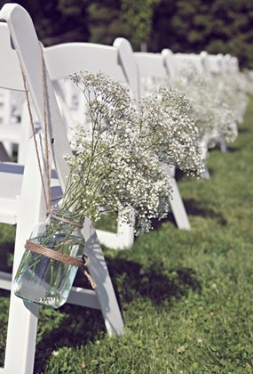 I like the large mason jar with baby's breath hanging from chair- maybe use ribbon instead?