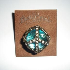 Lucky Brand Ring – Crystal Peace Sign - Size 7 - 8 Flex Fit  New without Tags New without ring card Cello-Packed with Gift Pouch  Please Look at My Other Items Up For Sale for More Great Deals!  Shipping to the United States Only!  Thank You For Look...