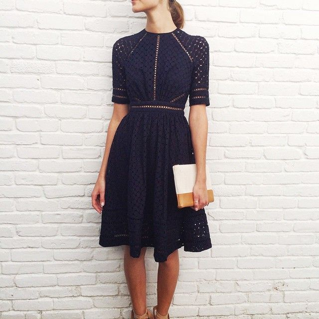 East Hampton: Mia at our East Hampton store wears Ryker Broidery Day Dress in Navy with Beach Clutch. #easthampton #27newtown #inthenavy