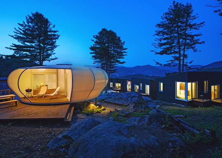Wooden cabins and tents on stilts provide accommodation at South Korean glamping site.