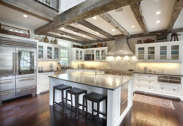 white kitchen beamed ceilings Hamptons house