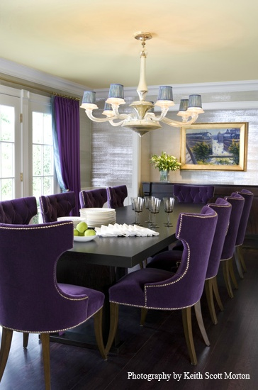 Dramatic dining room with purple chairs and drapes