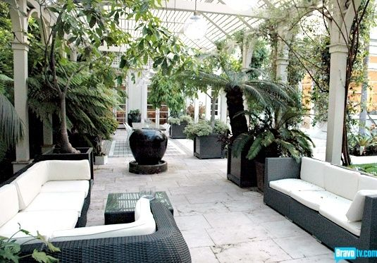 outdoor miami style furniture, add black pots for tall plants