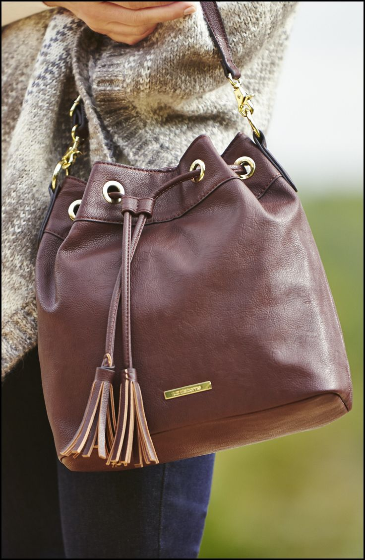 What's a great outfit without the perfect finishing touch? Liz Claiborne crossbody bucket bag, exclusively at JCPenney.