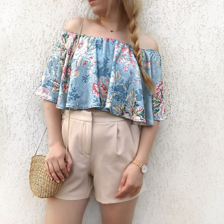 Off shoulder floral top with nude shorts and straw bag. Summer look and outfit