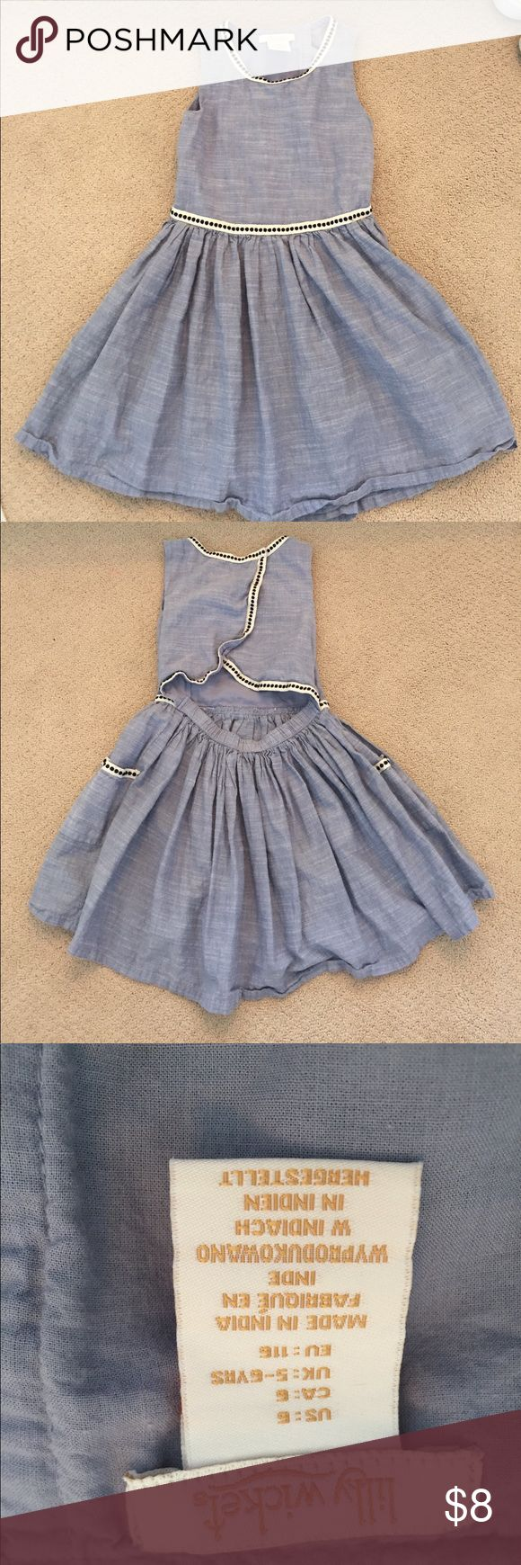 Girls Lily Wicket Dress This dress is a denim color with an open back and a pocket on each side. It was barely worn and is in great condition. Please feel free to ask for a lower price or comment any questions!👍💘 Dresses
