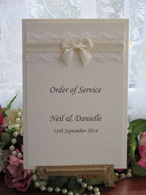 C0074 Pure innocence Ivory Lace Satin Order of Service Available from www.vintagelaceweddingcards.co.uk