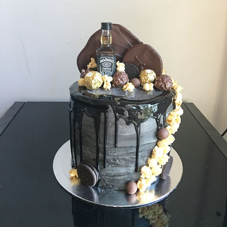 Black drip cake with lots of goodies for my husband's birthday. Jack Daniels