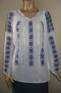 Hand embroidered with navy blue cotton thread Romanian peasant blouse available at www.greatblouses.com .