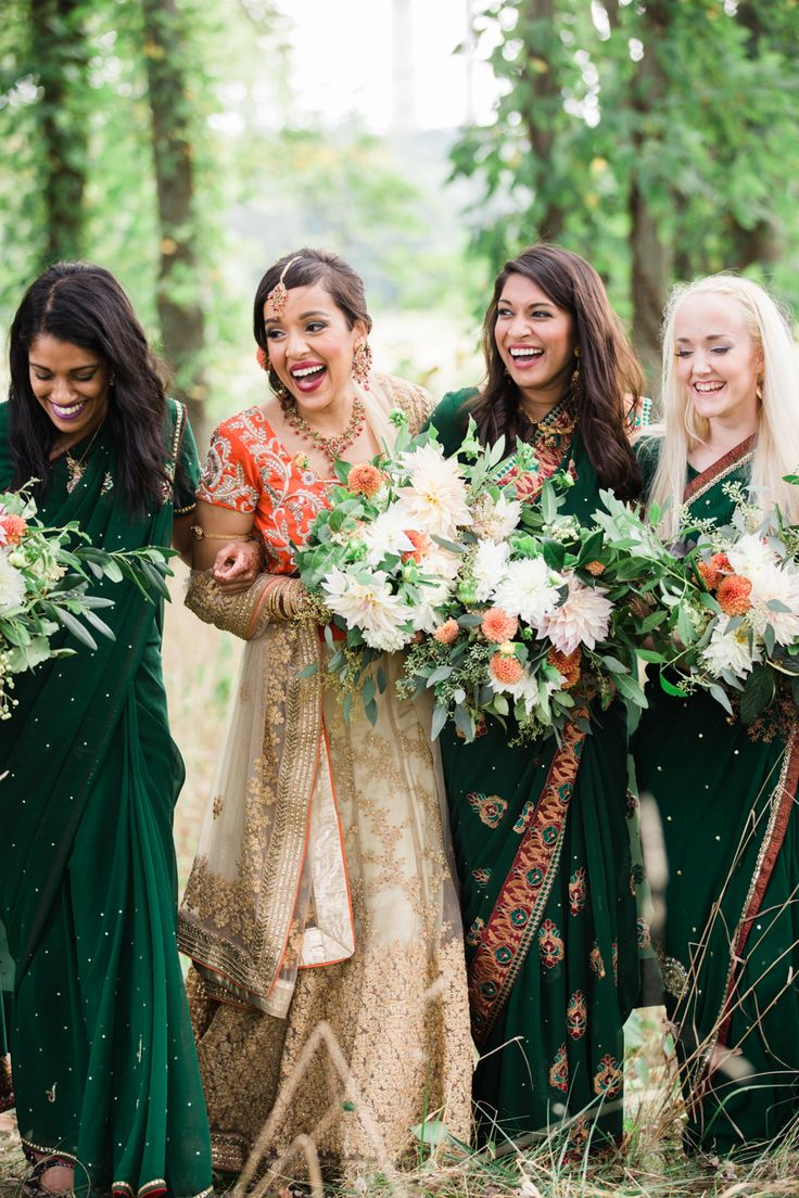 casto; Riverside on the Potomac; virginia wedding; JEM Events; Lynnvale Studios; indian wedding; interfaith wedding; modern indian wedding; bride and bridesmaids laughing wearing saris;