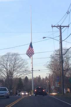 President Obama earlier today ordered flags flown at half staff at all federal and military buildings and installations. Of those thousands of flags, perhaps none flew as mournfully as this one in the town center of Newtown, Conn., hours after 18 children were killed in school shooting. (Kyle Lyddy)