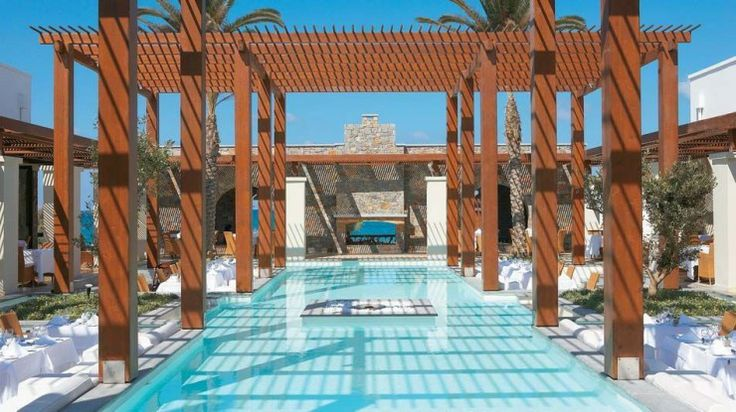 Amirandes Grecotel Exclusive Resort, Crete, Greece. The design of this luxurious resort was inspired by the Minoan palaces. The Olympic size seawater pool is directed to the sea and has an access from the private suites.