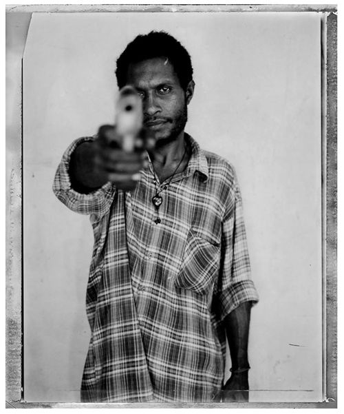 © Stephen Dupont 'Samson Maipe' 2004 from the Raskols Series   Edition: 1/15 $2,500 (unframed), $2,800 (framed) Medium: Silver Gelatin Print All prices are inclusive of a Goods & Services Tax (GST)