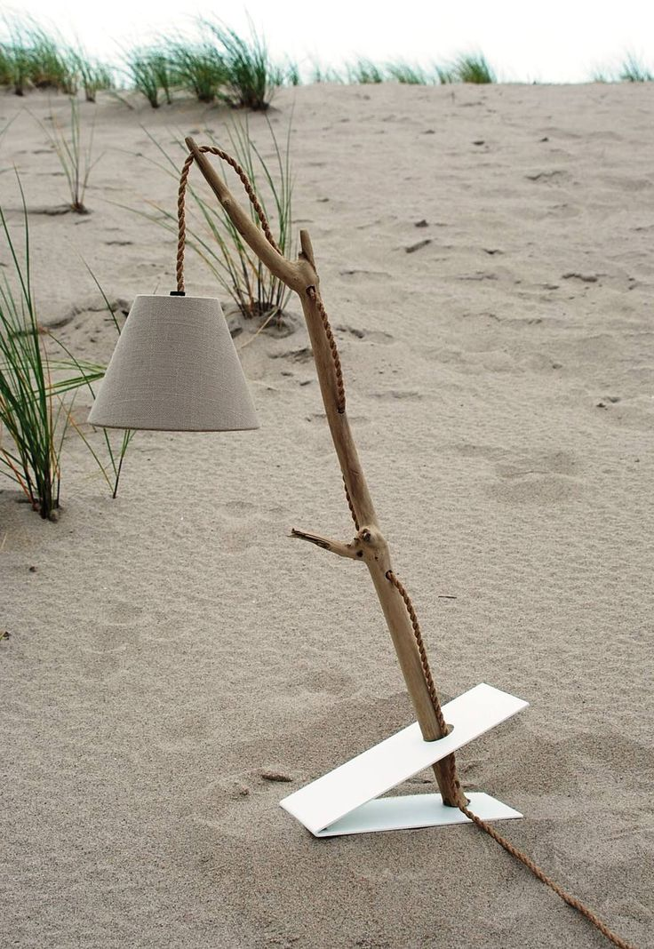 These modern lamps are made from driftwood.…