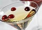 WHITE COSMOPOLITAN COCKTAIL - 1 1/2 oz vodka - - 1/2 oz Cointreau - - 1/4 oz white cranberry juice -