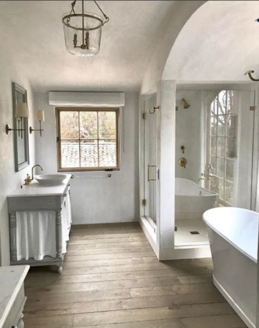 Master bathroom in a Mediterranean Modern Farmhouse in Malibu by Giannetti Home and Jones Builders Group