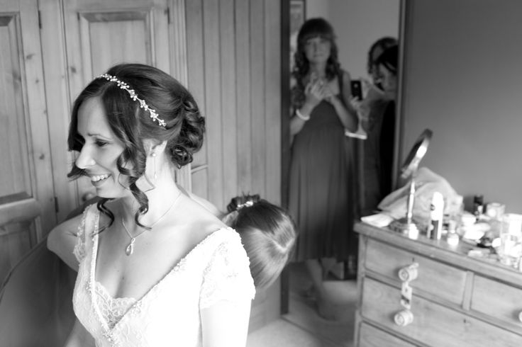 The lovely bride and her bridesmaids getting ready.