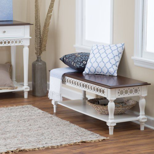 Turned legs and decorative openwork apron Solid poplar, maple veneer, and engineered wood White-painted base with walnut-finished top