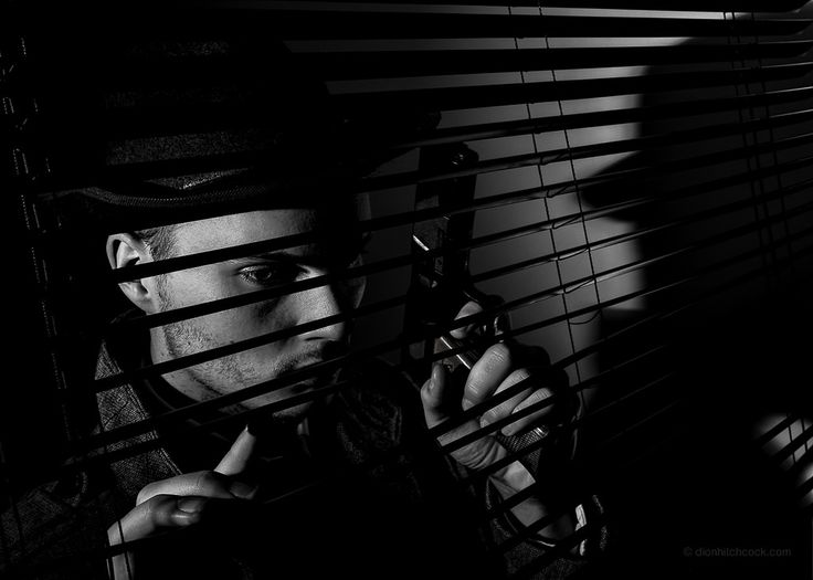 https://flic.kr/p/nzhJd2 | Detective Mike - Film Noir. | Two strobes (SB910s, triggered by Pocketwizards).  First with grid camera left (slightly behind model) and second low power fill light bounced off wall camera right.
