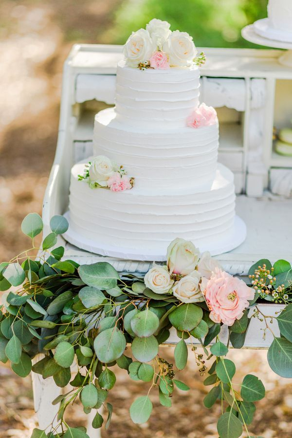White wedding cake with combed icing | Photo by Elle Lily