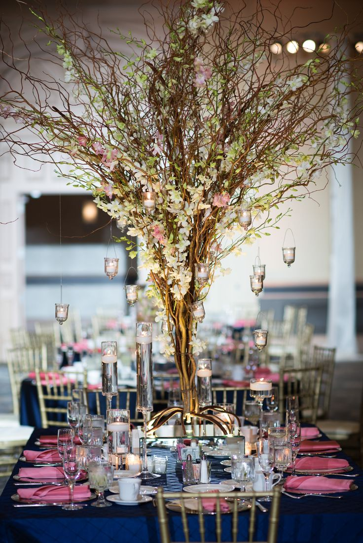 Beautiful Wedding Centerpiece With Curly Willow Branches Orchids And Candleli Beautiful Wedding Centerpiece Rustic Wedding Flowers Wedding Table Centerpieces