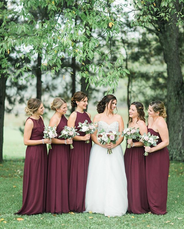 These assorted wine colored @BillLevkoff #bridesmaid dresses were the PERFECT choice for a #FallWedding! Style #'s from left to right: 1161, 1164, 1165, 165, 165.  #theknot : @kendraruthphoto | Link in bio to see more from @BillLevkoff. #AD