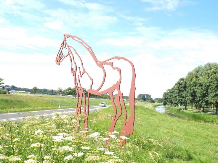 A metal horse on the side of the road in Holland