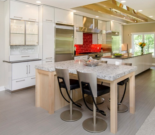 modern kitchen with sleek white cabinets and red brick