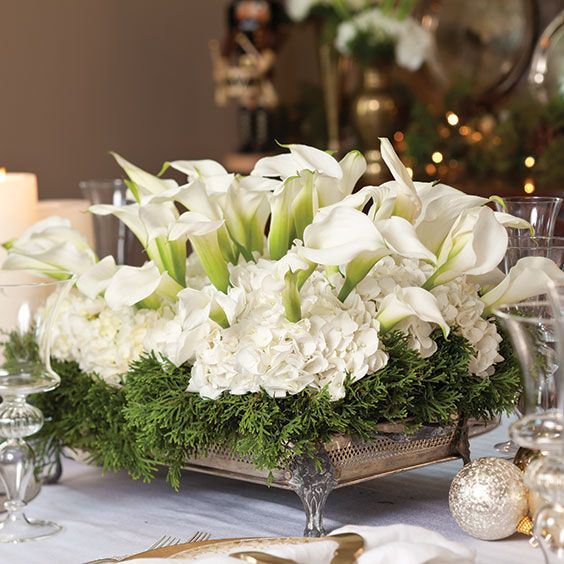 Best 25 christmas floral arrangements ideas only on for Christmas flower table decorations