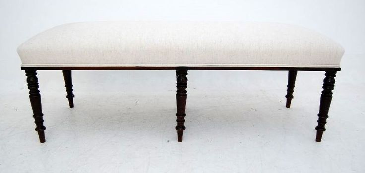 Large antique mahogany stool or window seat, with six turned mahogany legs. I believe the legs are Victorian. I obtained the stool already constructed & just had it re-upholstered. This stool would be really practicable at the end of a double bed, although it could have many other uses. It's in lovely condition & beautifully upholstered.