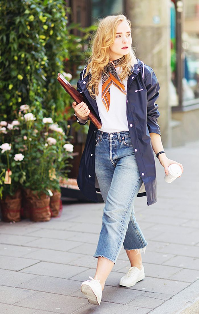 Fanny Ekstrand in a jacket, white t-shirt, neck scarf, and high waisted jeans