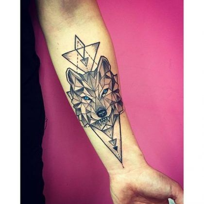 Blue-Eyed Geometric Wolf on Triangles Forearm Tattoo