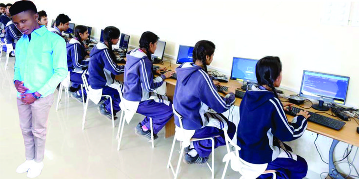 THIS IS A COMPUTER CENTER WHERE STUDENT LEARN MORE ABOUT COMPUTER. THE GUY STANDING IS THE OWNER OF THE COMPUTER CENTER HIS NAME IS (MOSES)