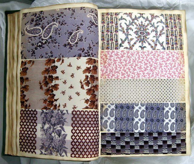 """Sample Book, ca. 1857 Green cloth bound volume of 1,823 samples of printed cottons mounted on paper. Title page marked """"A1857."""" Many samples of miniature geometric and floral patterns and combinations of both forms. Larger pattern with border designs and warp stripes. Cooper-Hewitt Museum"""