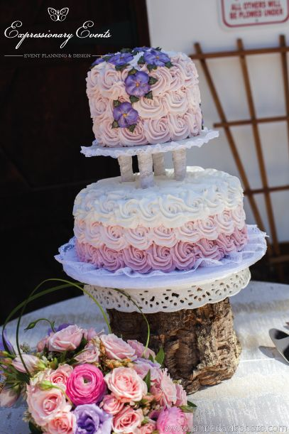 Cake that was made with rosettes in an ombre effect of pinks and purples by Love Me Sweets.