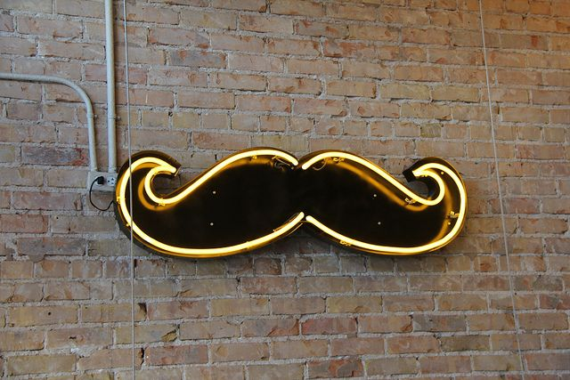 Moustache neon in the SoCo (South Congress) neighborhood in Austin, TX - Photography by Valerie Lawson, via Flickr