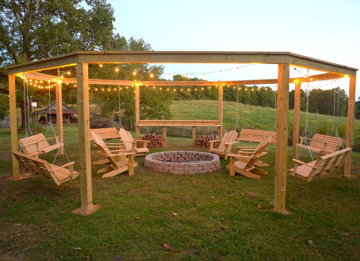 GATHERING SPOT This summer oasis may take you some time, but once it's complete, your outdoor seating structure will be the envy of the neighborhood. With six wooden porch swings—all surrounding a built-in fire pit—it's the perfect place to spend your summer surrounded by friends and family.