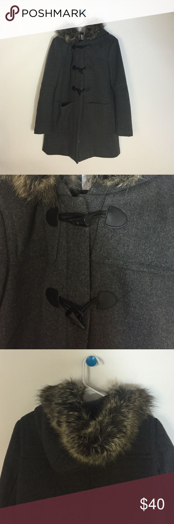 Bcbgeneration coat Charcoal grey peacoat. two front pockets. zipper and toggle closure. Hoodie with removable fur. worn one winter season BCBGeneration Jackets & Coats Pea Coats