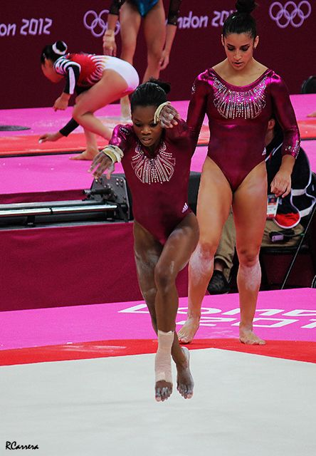 Gabby Douglas and Aly Raisman warming up - All Around - London 2012. Gabby looks a little funny in this one, but it's because she's in the middle of a tumbling pass.