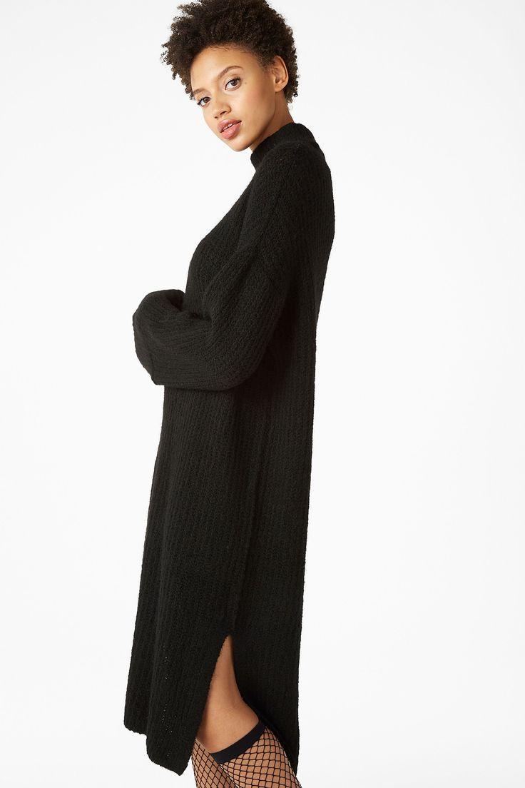 <p>This cool dress packs a ton of knit cosiness right down to ur ankles. With a 70s polo-neck and wide, flowy sleeves, there are also statement slits at bot