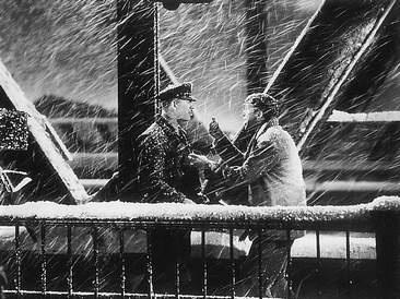 George Bailey (James Stewart) shows Officer Bert (Ward Bond) Zuzu's petals.  It's a Wonderful Life (1946)