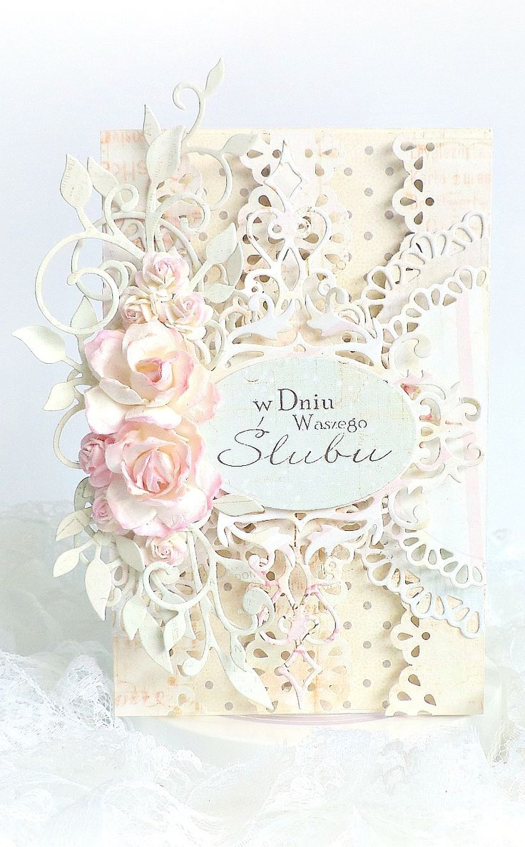 It is as if this card was created to showcase die cutting. There are so many fantastic layers and the flowers on top add depth to this piece. Even though the colors are muted, the eye is drawn to the center oval die cut with wording. Beautiful!
